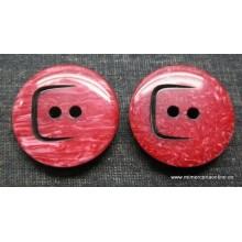 Botón rojo oscuro efecto mármol, dibujo perforado, 38 mm