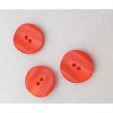 Botón rojo con relieves,...
