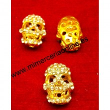 Calavera color oro de...