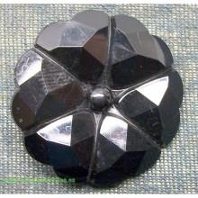 Botón de color negro con...
