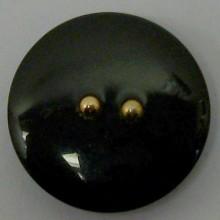 Botón negro, con dos bolas...