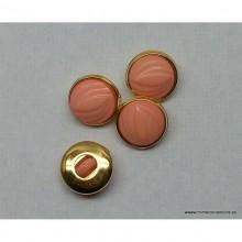 Botón rosa pálido con cerco...